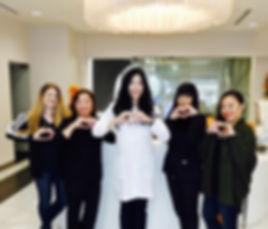 Dr. Cheng and her team making heart symbols