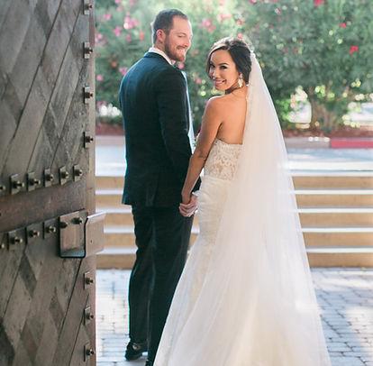 Couple walking through a door at their wedding