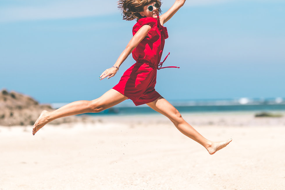 woman-in-red-jumping-1129605.jpg