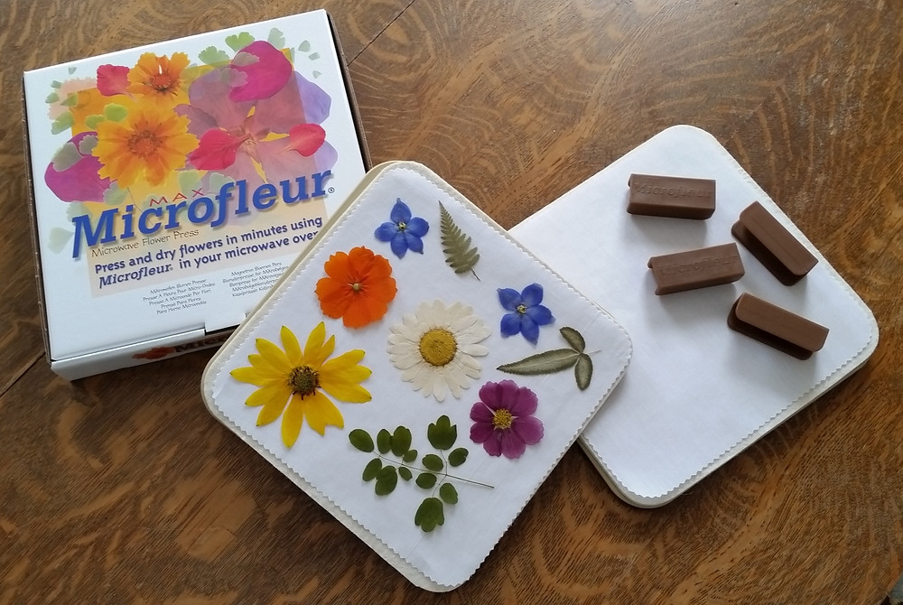 Picture of a microfleur press and  some pressed flowers