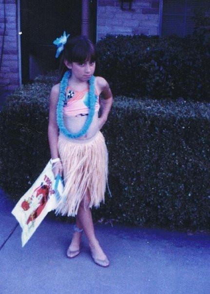 Me as an 8 yr old Hula girl aka Diva posing for Halloween