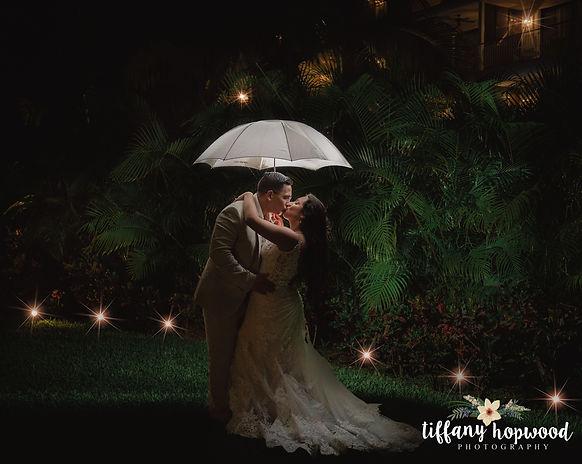 Bride and groom kissing in the rain at their Cancun Rivera Maya Destination Wedding