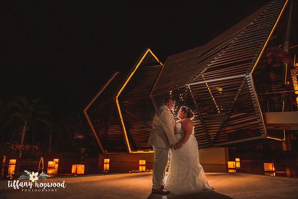 Dramatic night destination wedding photography at the Royalton Riveira Cancun
