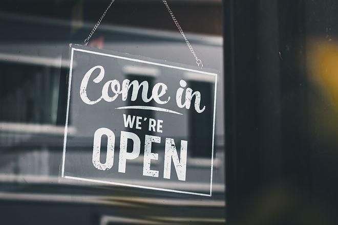 Come in we're open, vintage black retro sign in glass door storefront.jpg