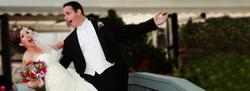 Groom Dips Bride over foot bridge