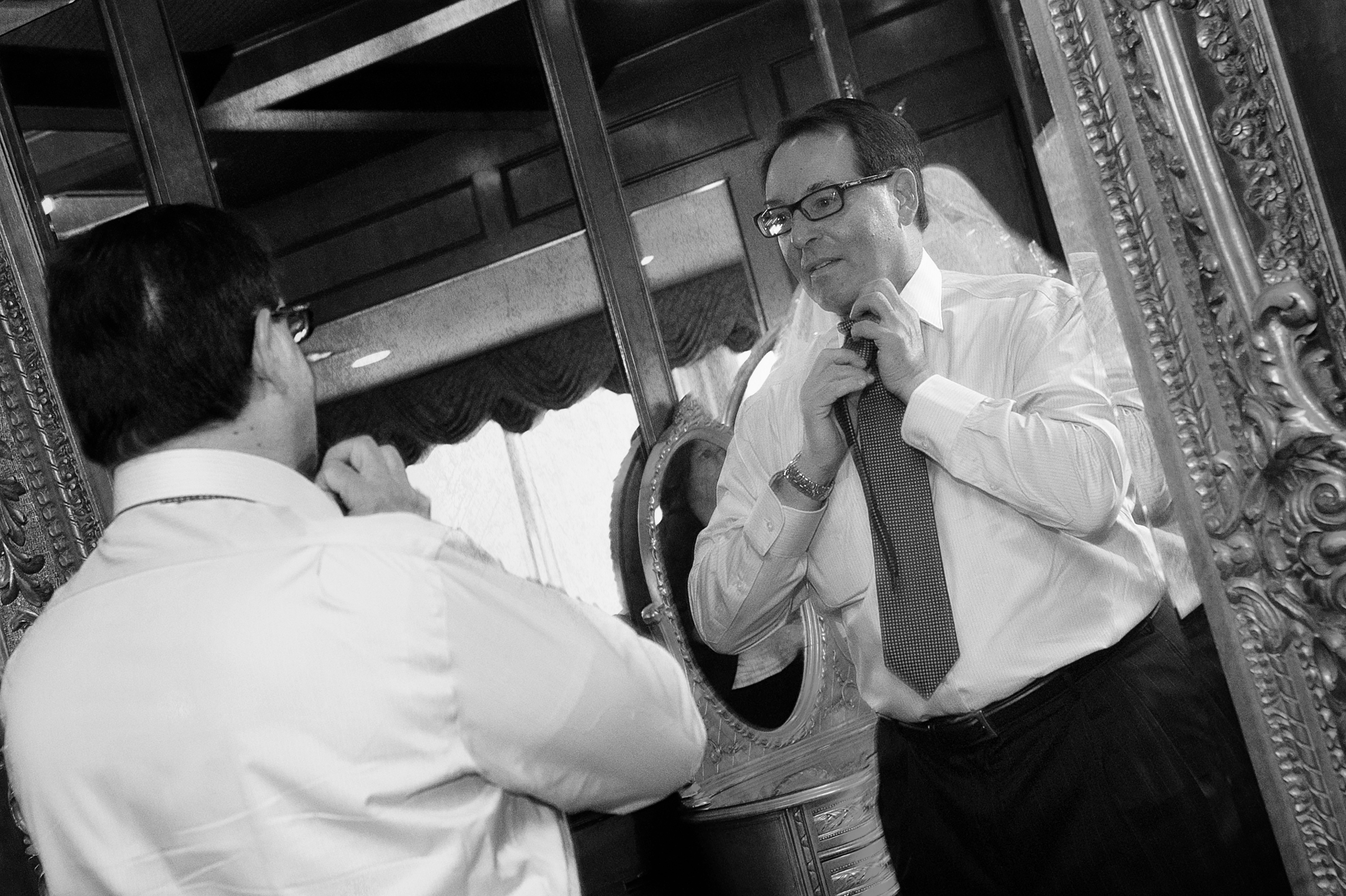 Groom fixes tie