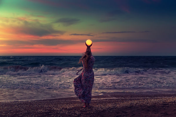 The girl holds the moon in her hands. Be
