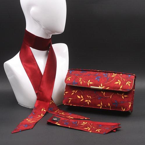 Clutch bag in seta rossa stampata con fiori stilizzati, nelle tonalità del giallo e azzurro, con 2 foulard abbinati