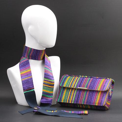 Clutch bag in seta rigata, nelle tonalità del viola, verde, giallo e blu.