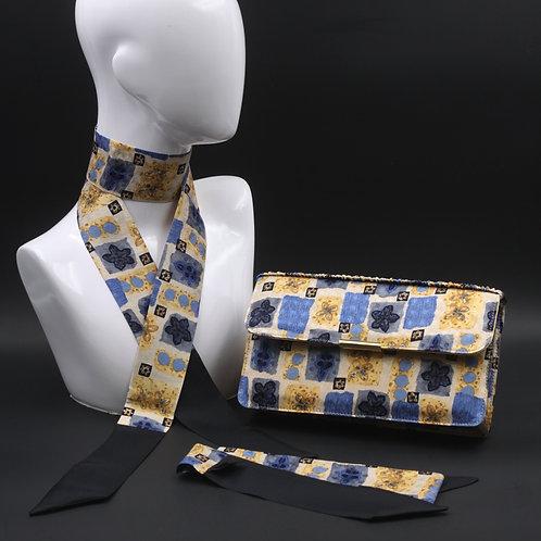 Clutch bag in seta blu stampata con fiori stilizzati, nelle tonalità dell'azzurro e giallo, con 2 foulard abbinati