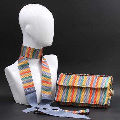 Clutch bag in seta rigata, nelle tonalità del giallo, arancione, verde e azzurro.
