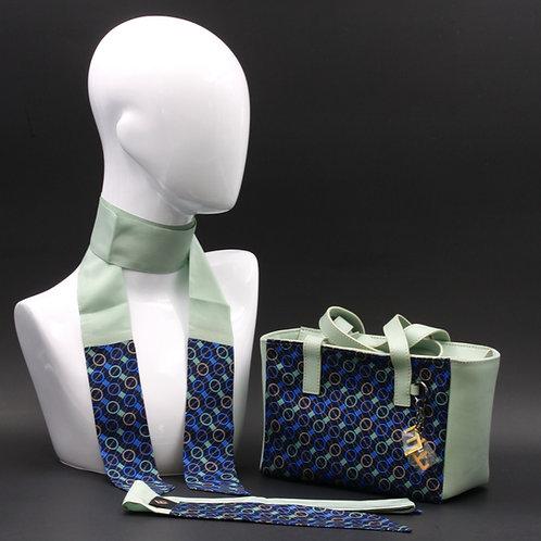 Borsa a spalla in vera pelle verdee inserti in seta con stampa geometrica, con tonalità blu e verde acqua e manici in vera