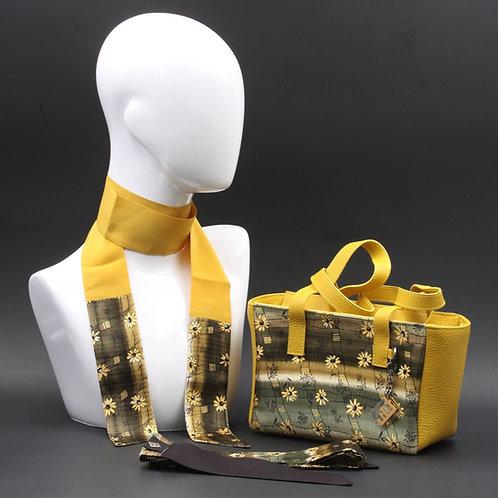 Borsa a spalla in vera pelle giallae inserti in seta con stampa floreale, con tonalità grigie e gialle e manici in pelle