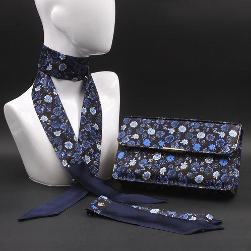 Clutch bag in seta blu stampata con fiori stilizzati, nelle tonalità dei blu, con 2 foulard abbinati