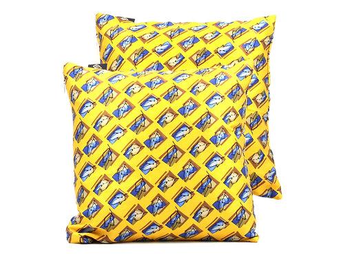 Cusciniin seta gialla con disegno geometrico e foglie
