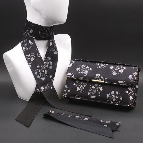 Clutch bag in seta nera stampata con fiori stilizzati, nelle tonalità del grigio, con 2 foulard abbinati