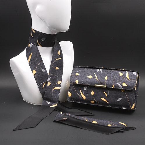 Clutch bag in seta grigia stampata con fiori stilizzati, nelle tonalità del giallo e grigia, con 2 foulard abbinati.