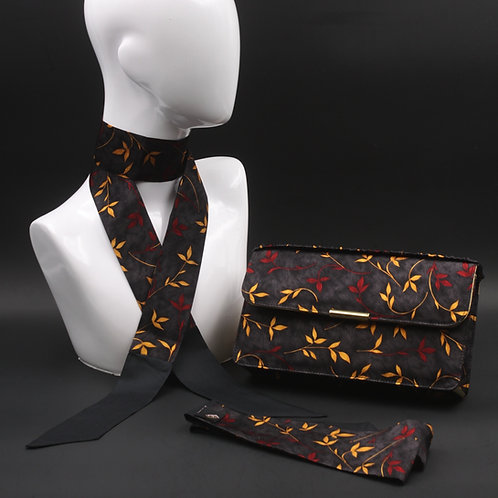 Clutch bag in seta nera stampata con fiori stilizzati, nelle tonalità del rosso e giallo, con 2 foulard abbinati