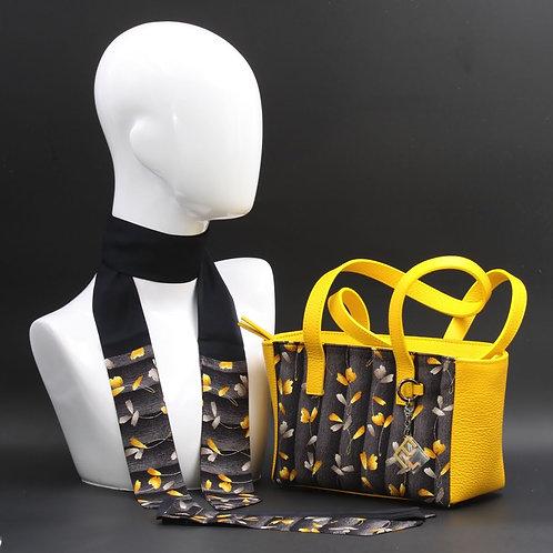 Borsa a spalla in vera pelle gialla e inserti in seta con stampa floreale, con tonalità gialla e grigia e manici in pelle