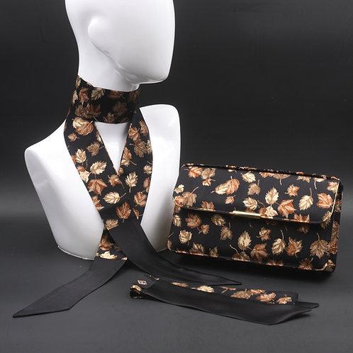 Clutch bag in seta nera stampata con foglienelle tonalità del beige, con 2 foulard abbinati