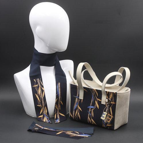 Borsa a spalla in camosciobeige e inserti inseta con stampa floreale, con tonalità blue giallo ocra e manici in vera pelle