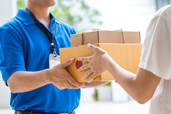 woman-hand-accepting-delivery-boxes-from