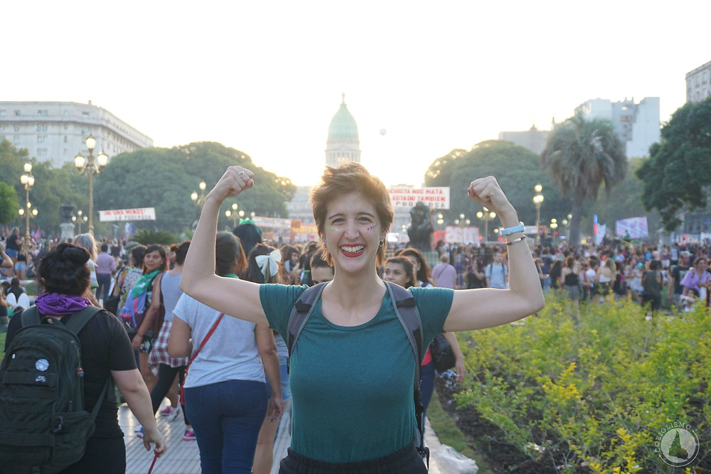 Valentina standing in front of Congress, flexing her muscles