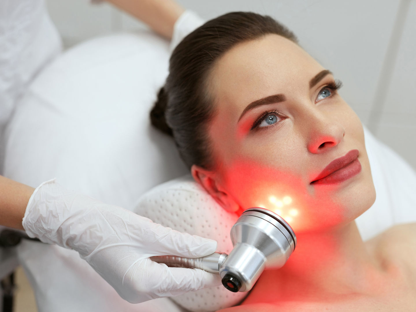 LED Facial Beauty Treatment Dallas Salon. Woman Doing Red light