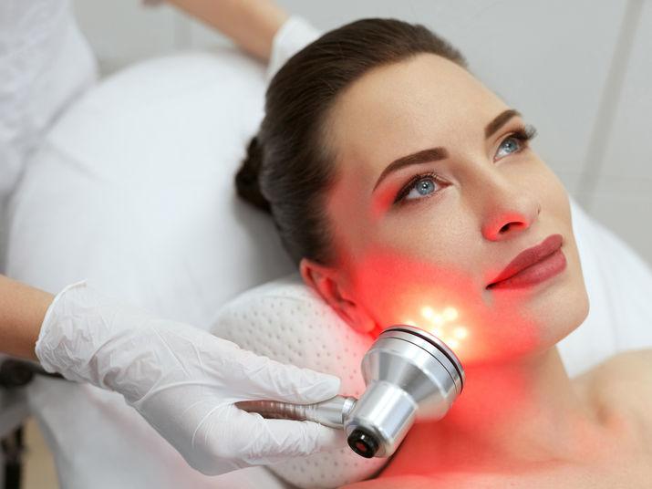 LED Facial Beauty Treatment Dallas Salon. Woman Doing Red light