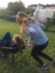 Children playing with wheel barrow
