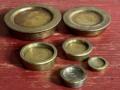 Set of brass balance scale weights