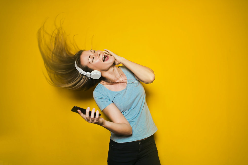 photography-of-woman-listening-to-music-