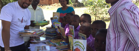 AIM library book donation to Sunshield P
