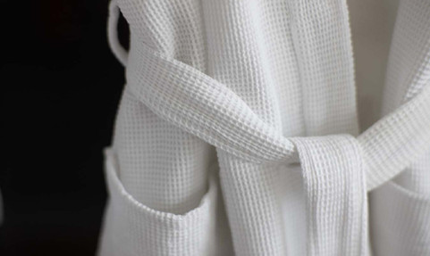 Cotton waffle robes and slippers spell contemporary comfort.