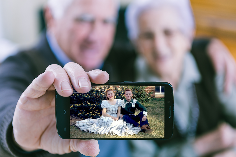 Old Couple Showing Image on Mobile.png