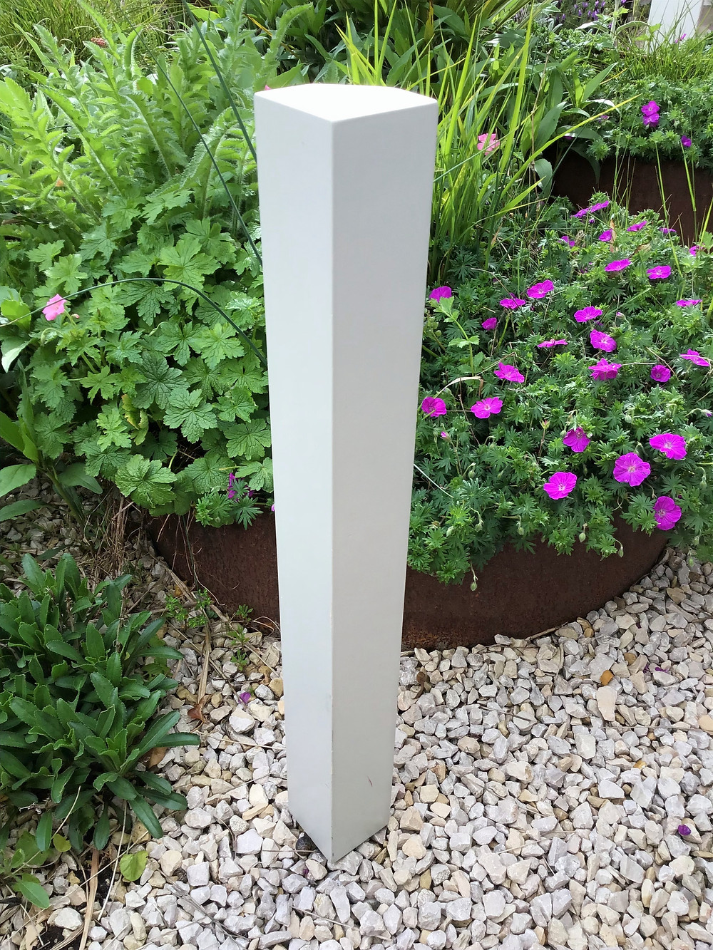 a single table leg standing in the garden