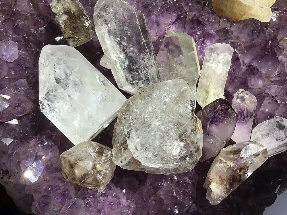 Quartz crystals on a large Amethyst cluster
