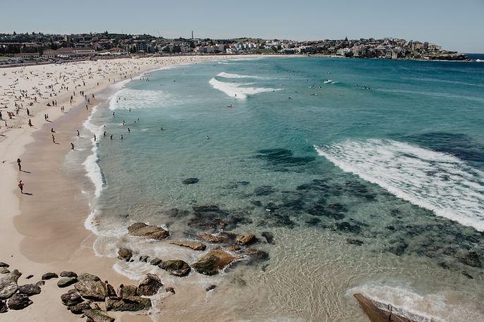 drone view of bondi beach clear blue water