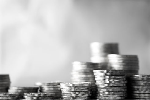 coins stacked up with blurred background