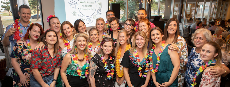 Image of 2019 EPHEA Conference attendees wearing Hawaiian-themed dress.