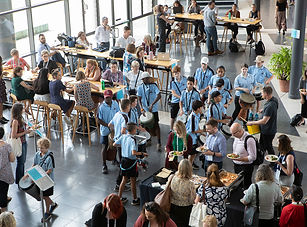 Image of primary school guests mingling with attendees at the 2019 EPHEA conference