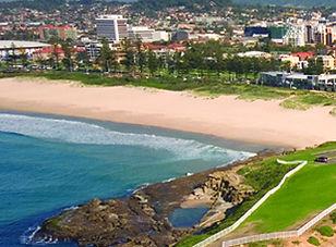 Image of beach at Wollongong looking back towards the city