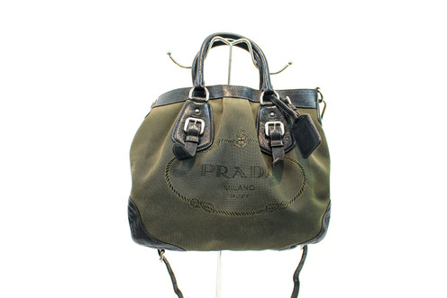 d249bae4853 Introducing the Prada Olive Green Jacquard Canvas Logo Crossbody. This  beautiful bag has a leather lining, a removable strap and gorgeous  silver-toned ...