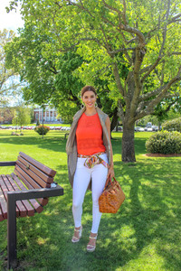 Model in Summer 2019 outfit with MCM Bag and louboutin shoes