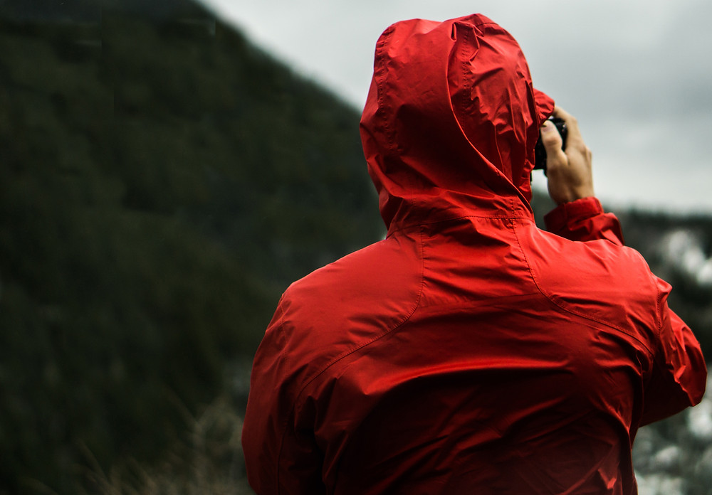 Man with red raincoat