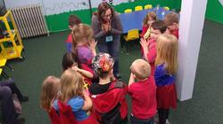 CHILDREN IN PRAYER! And one dude checkin