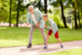 grandfather playing with grandson showing no pain