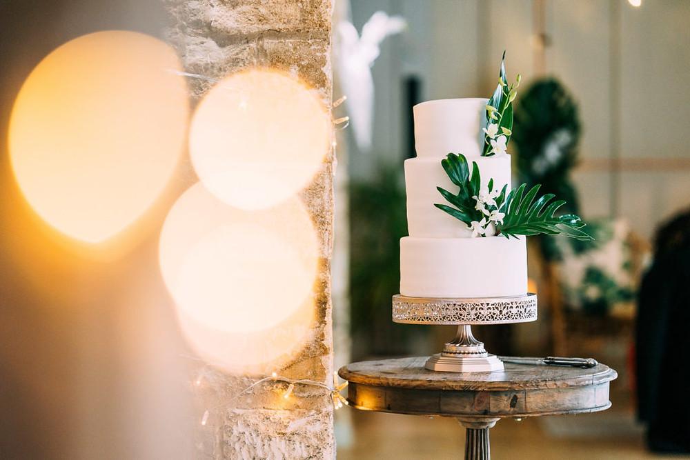 Tropical foliage wedding cake