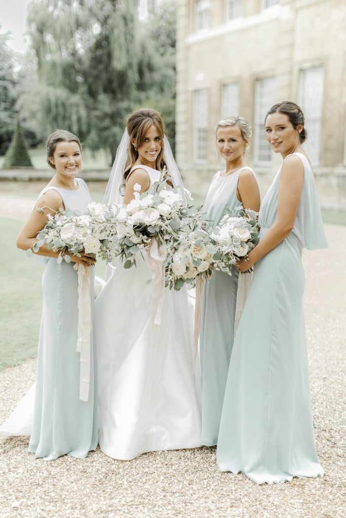 sage green bridesmaid dresses and summer florals