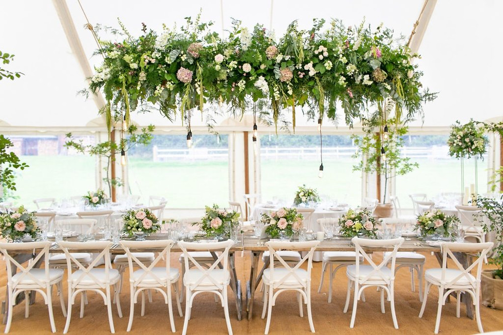 Hanging floral plank marquee
